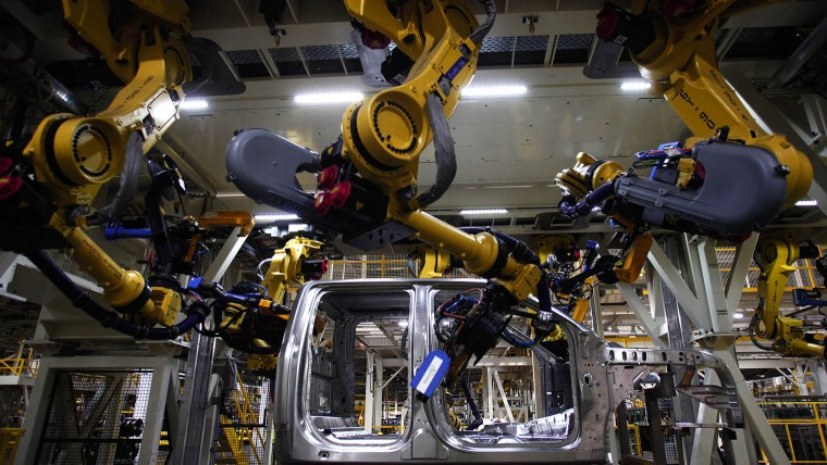 Robotic arms on the F-150 truck assembly line at Ford's plant in Dearborn, Michigan