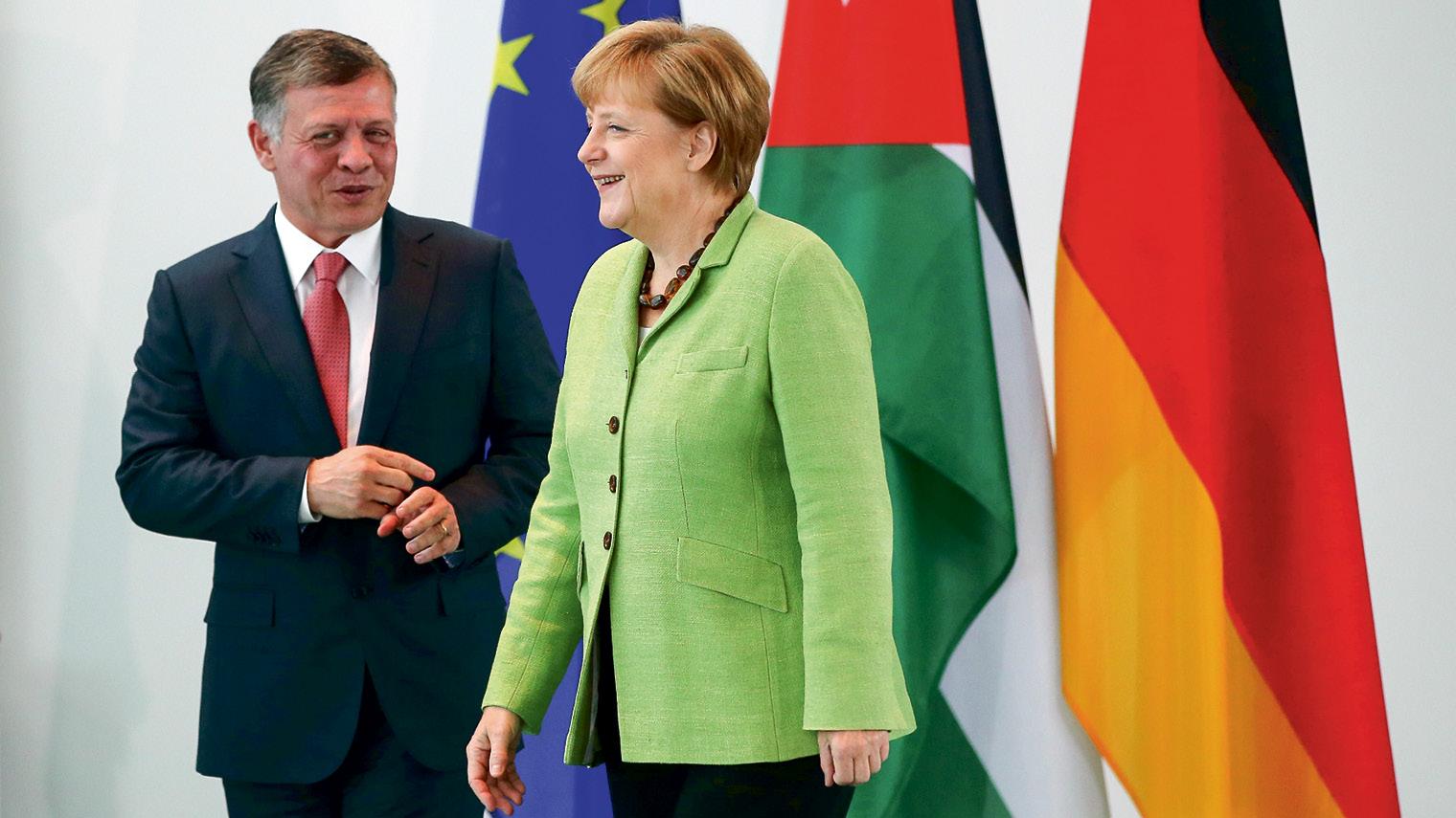 King Abdullah II with German chancellor Angela Merkel at a meeting in June 2014