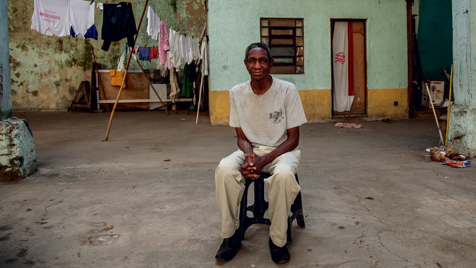 Paulo Cezar de Paula, 62, in the abandoned warehouse his family and two others have been occupying for the past three years. De Paula was evicted from the Quilombo das Guerreiras occupation in 2013 to make space for the Trump Towers Rio