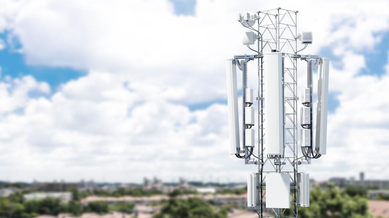 Ericsson suburban 5G mast by blue sky