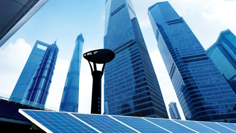 worm's eye view of skyscrapers with solar panels