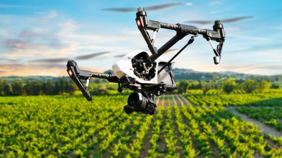 Innovation in agriculture: drone hovering over field