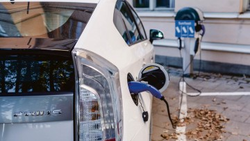 Toyota Prius hooked up to a charge port