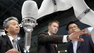 KUKA Robotics Corp's Roboter industrial robot on show at Tokyo's International Robot Exhibition