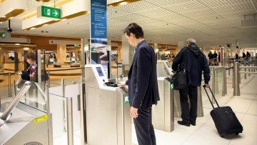 Self-service passport control with biometric technology at Amsterdam's Schiphol Airport