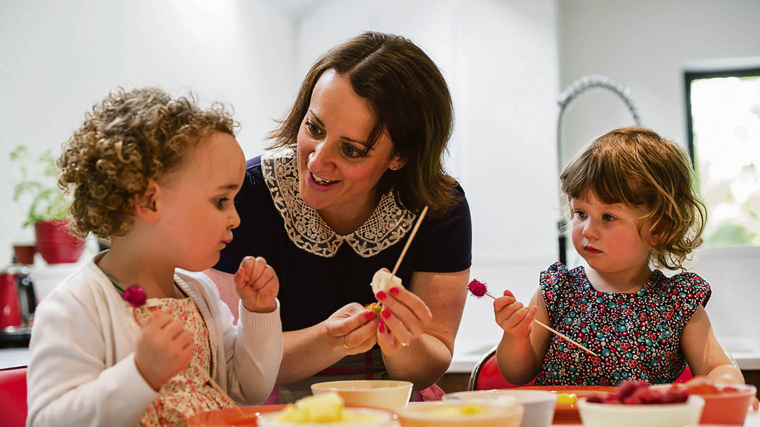 Jayne Haynes with children in a kitchen