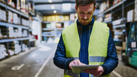 Warehouse employee using a tablet