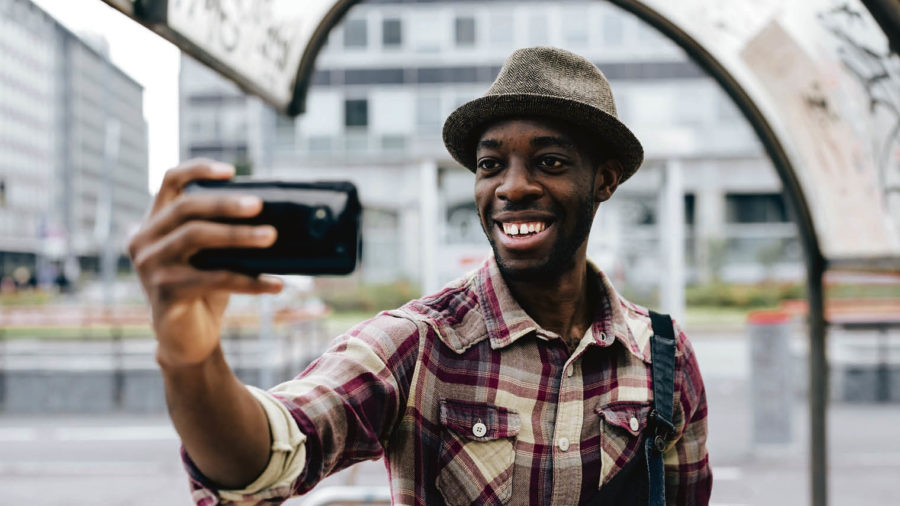 Man you using facial recognition authentication on smartphone