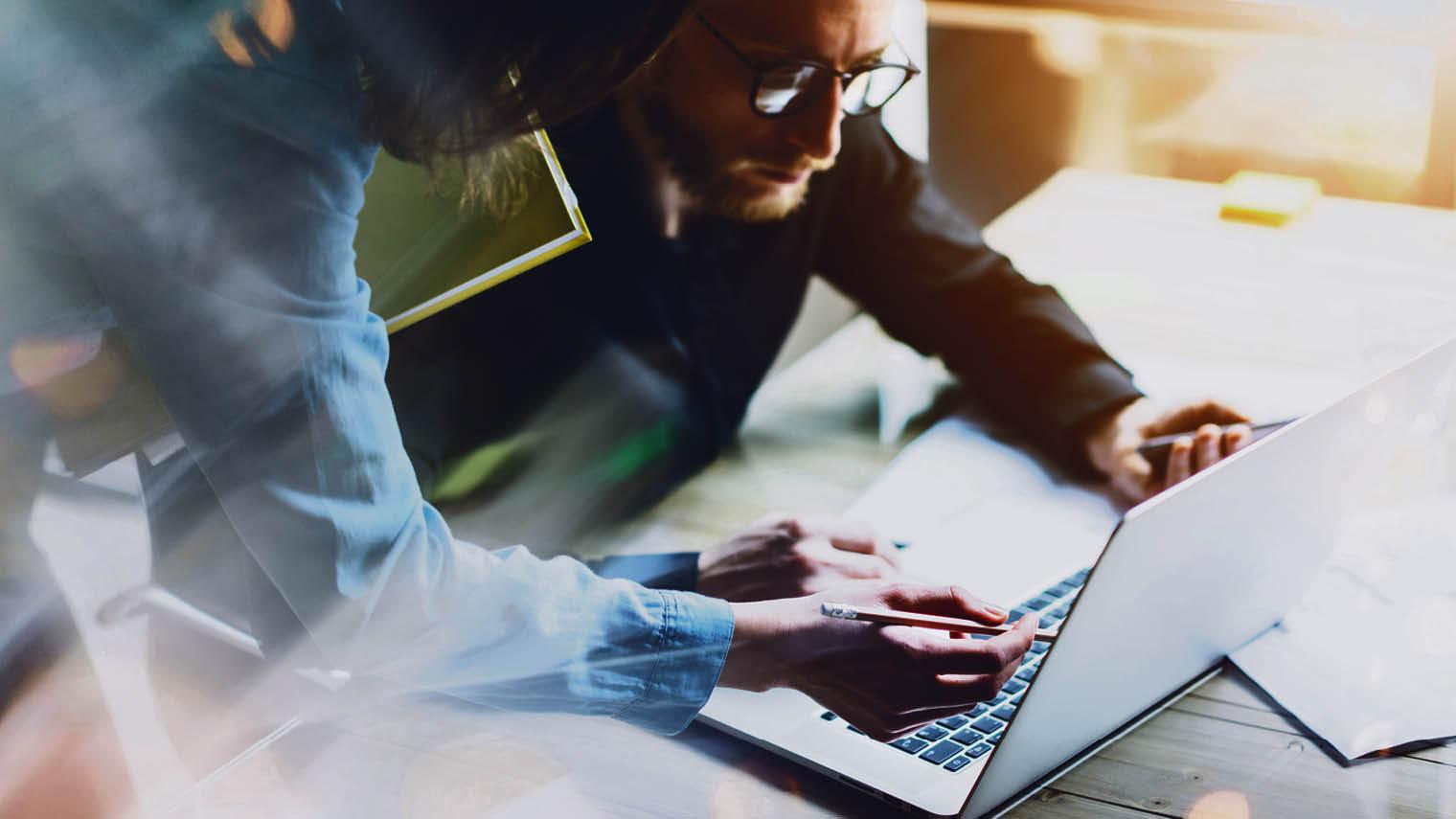 Professionals at a laptop
