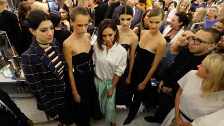 Victoria Beckham with models at a fashion show