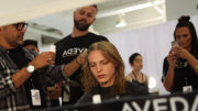 Model getting hair done at fashion show