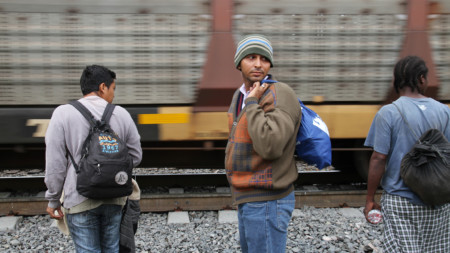 Migrants wait for La Bestia, the frieght train used to hitch a perilous ride north