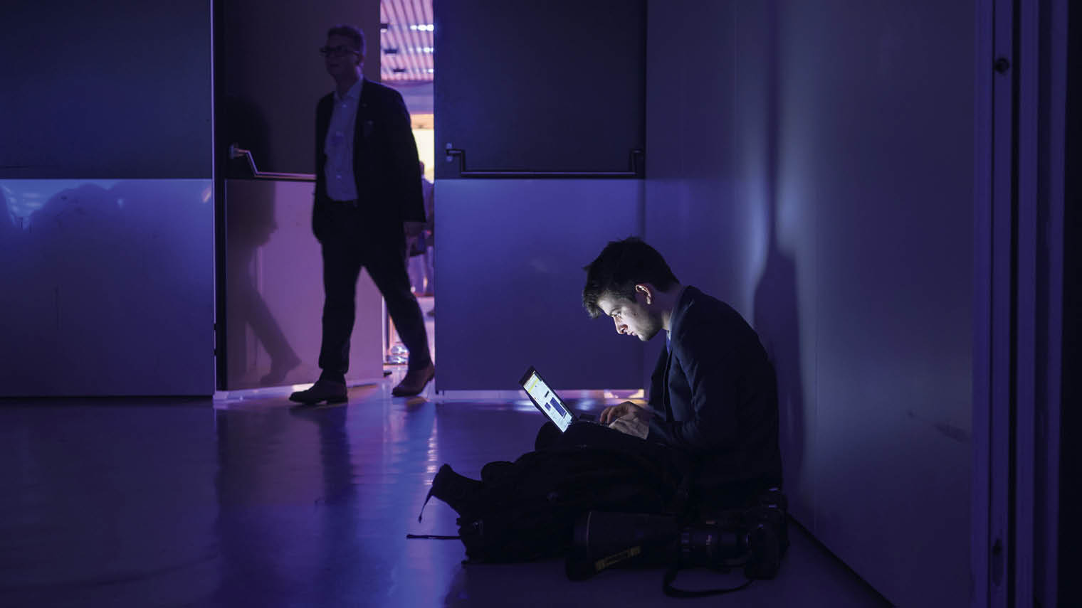 Person in a dark room on a laptop