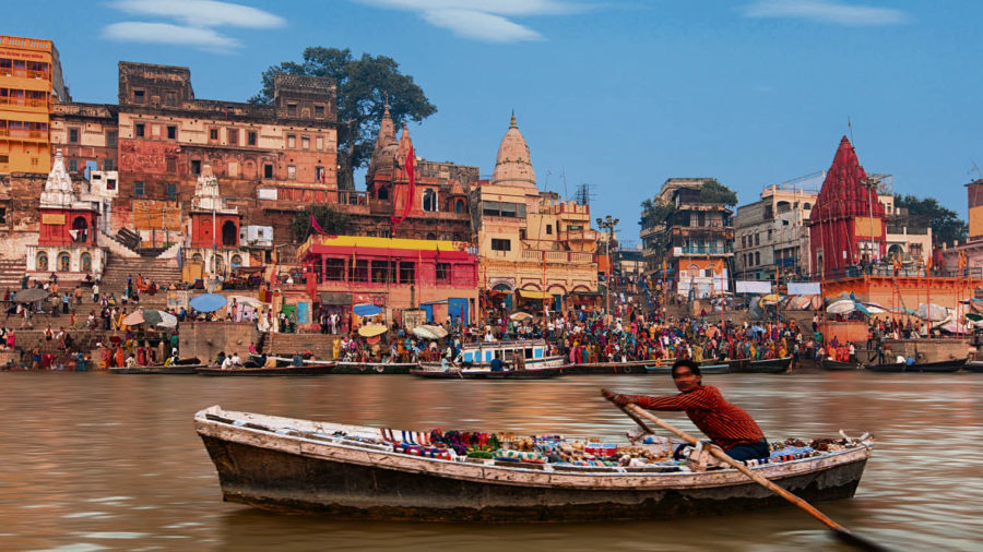 Man in rowing boat on River Ganges
