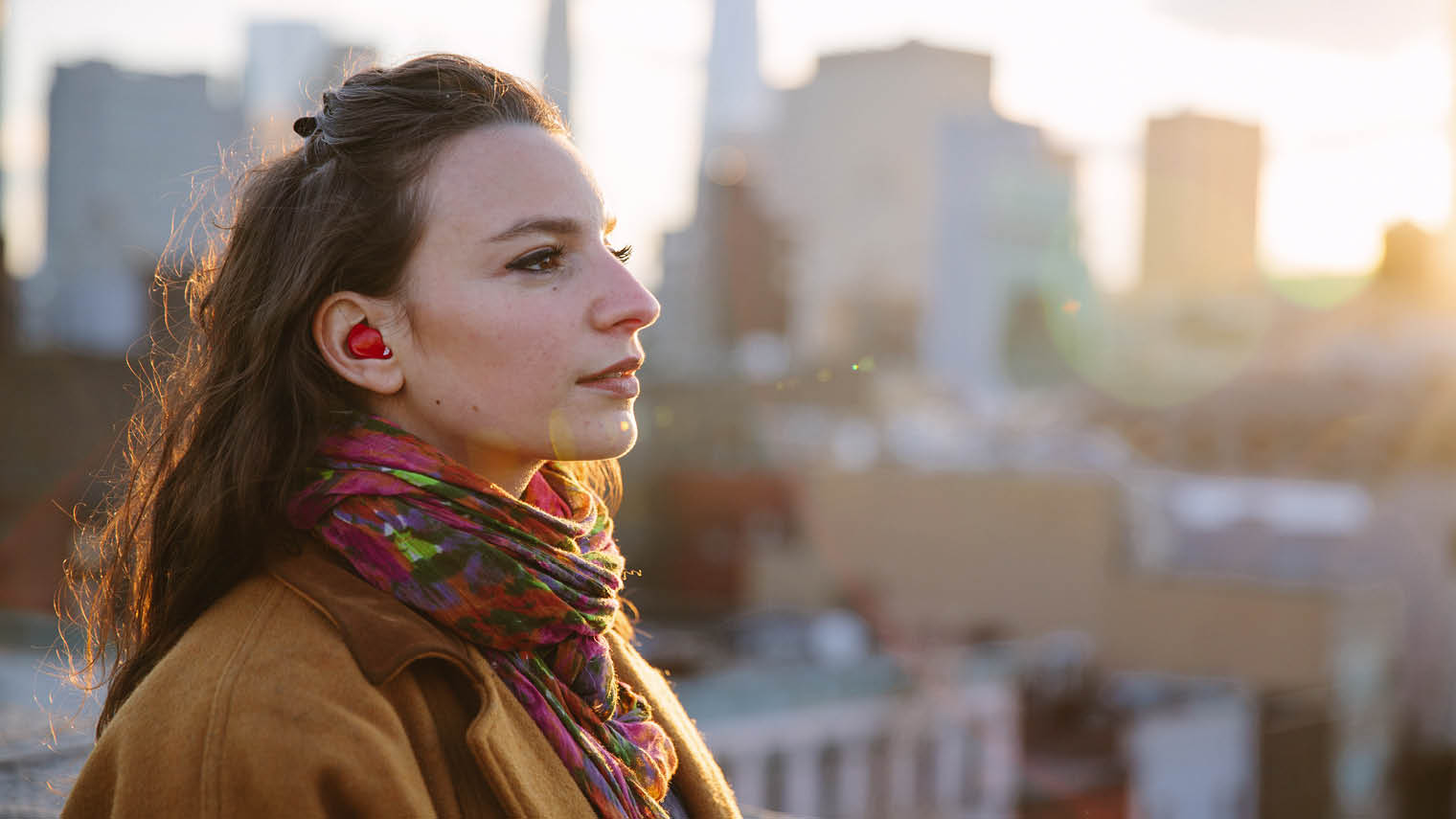 Young woman wearing pilot earplug translator