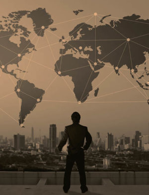 Businessman looking at a global map above cityscape