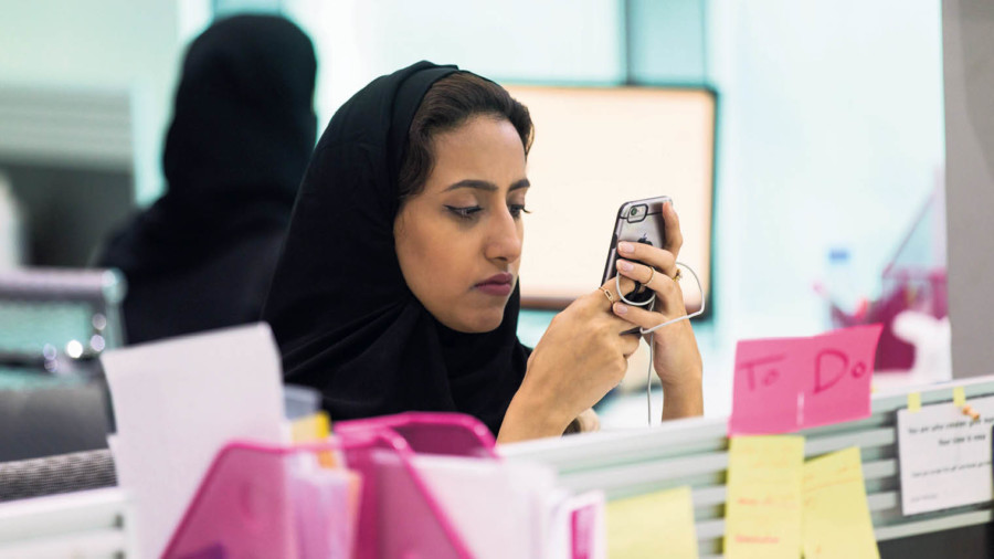 Retail professional on their phone at work