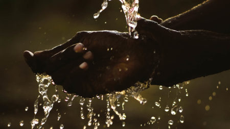 Hands being washed in water