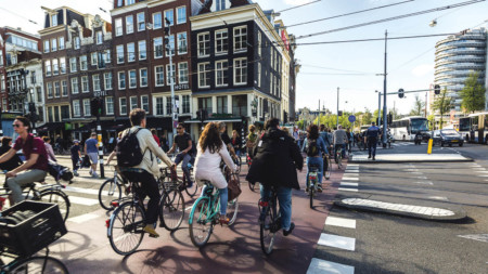 People cycling in Amsterdam