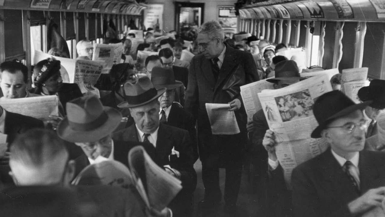 Vintage photo of people reading the newspaper on the train