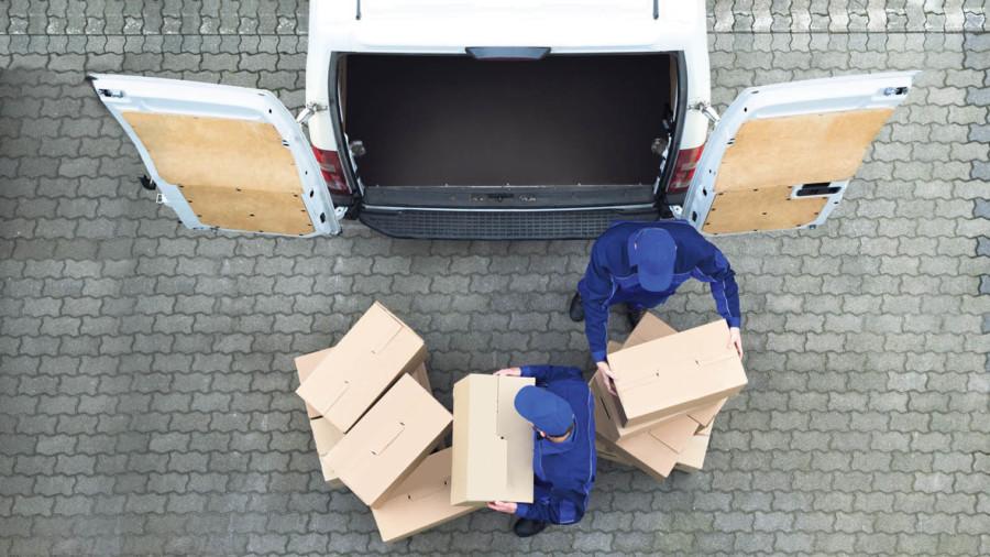 Yodel delivery men emptying a van