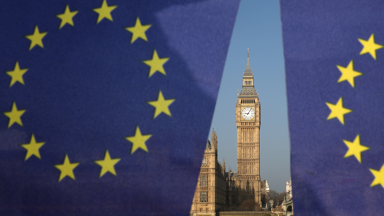LONDON, ENGLAND - MARCH 28: (EDITORS NOTE: This is a photo illustration.) EU flags outside the Houses of Parliament on March 28, 2017 in London, England. Article 50 will be triggered on March 29, and the process that will take Britain out of the European Union will begin. (Photo by Dan Kitwood/Getty Images)