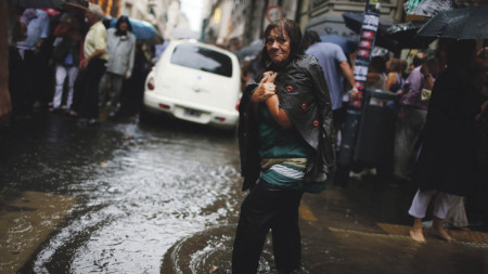 Lady walking in flood water in a city