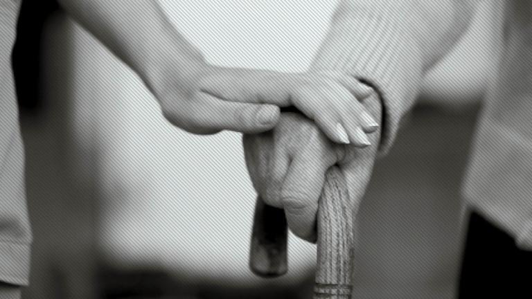 Carer comforting dementia patient
