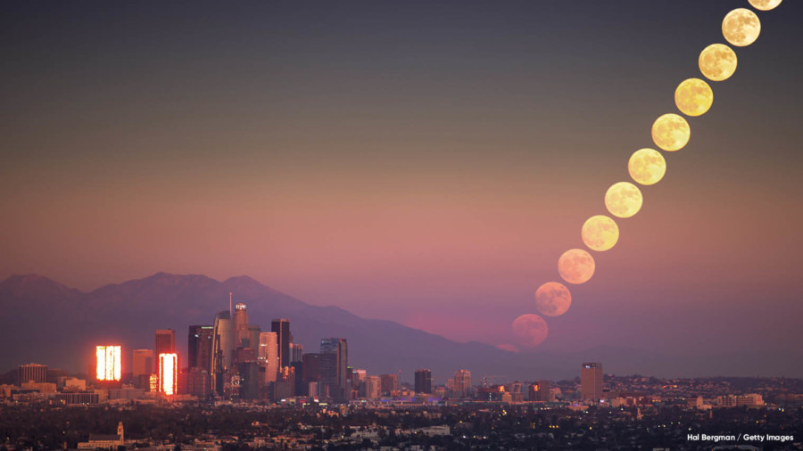 Sunset and numerous moons in the sky