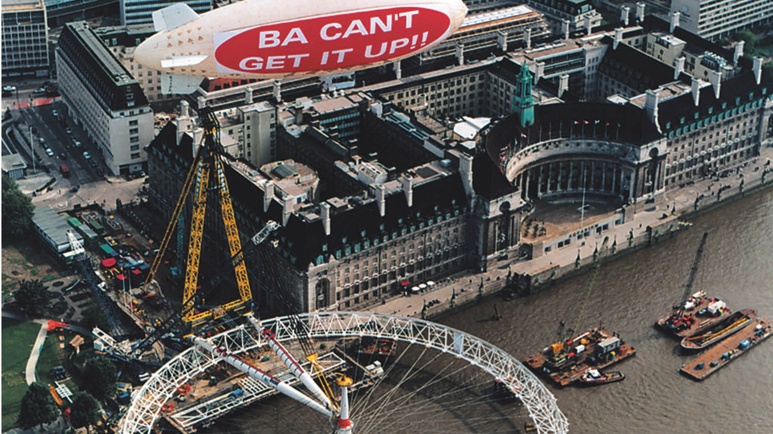 """Virgin blimp displays the sign """"BA can't get it up!!"""" after the then British Airwayssponsored London Eye had a technical problem erecting the wheel"""