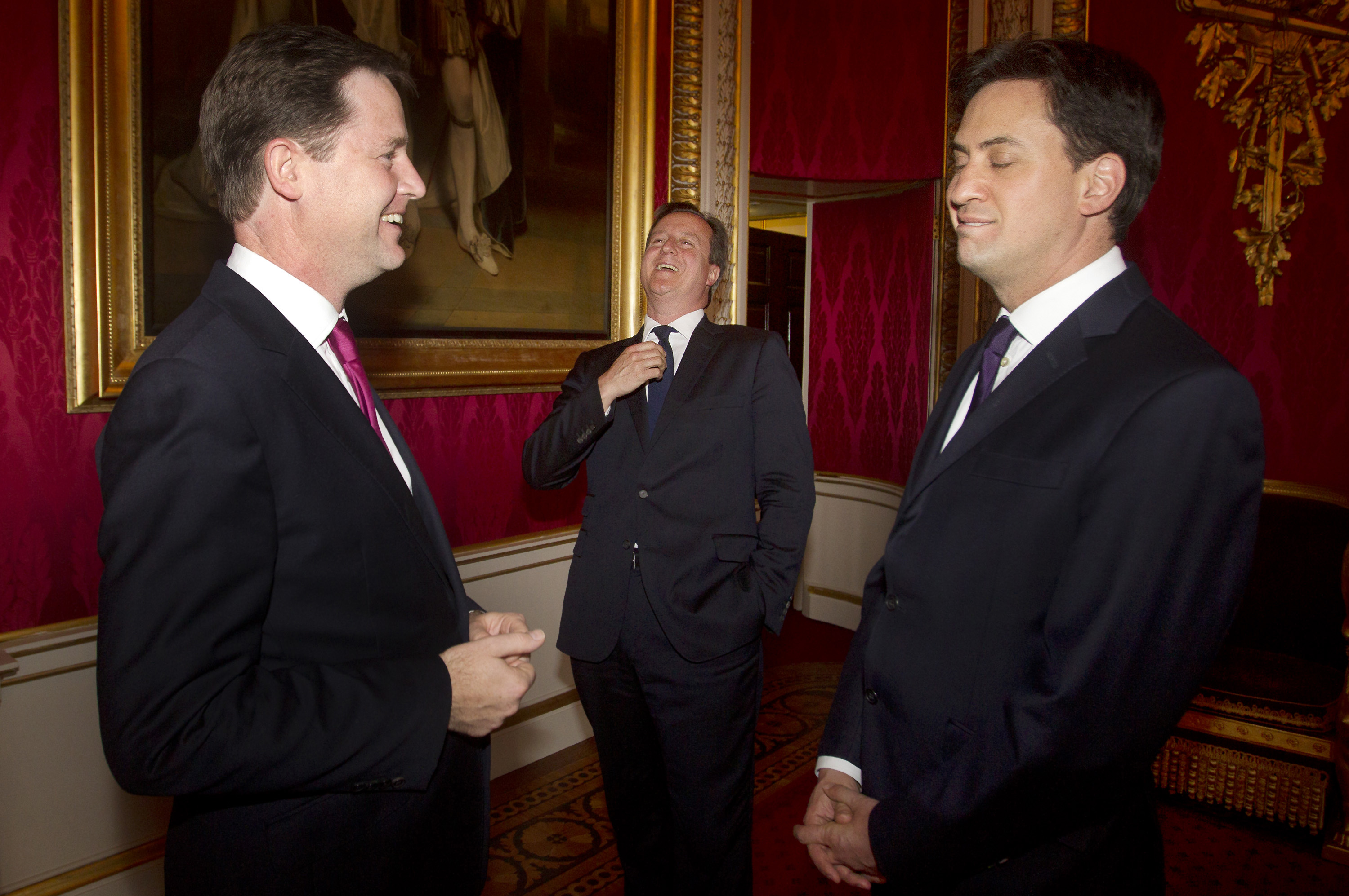 (From left to right) Deputy Prime Minister Nick Clegg, Prime Minister David Cameron and Labour Leader Ed Miliband share a joke during a reception to mark the inaugural Queen Elizabeth Prize for Engineering, at Buckingham Palace in central London on June 25, 2013. AFP PHOTO/POOL/LEWIS WHYLD (Photo credit should read LEWIS WHYLD/AFP/Getty Images)