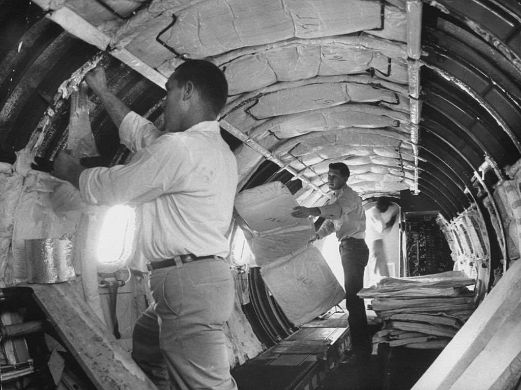 Lockheed workmen insulating private Jetstar plane with layers of foil for sound and temperature. (Photo by Shel Hershorn/The LIFE Images Collection/Getty Images)
