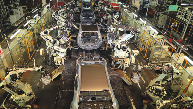 Vehicles move along a robotcontrolled production line at a Toyota assembly plant in Turkey