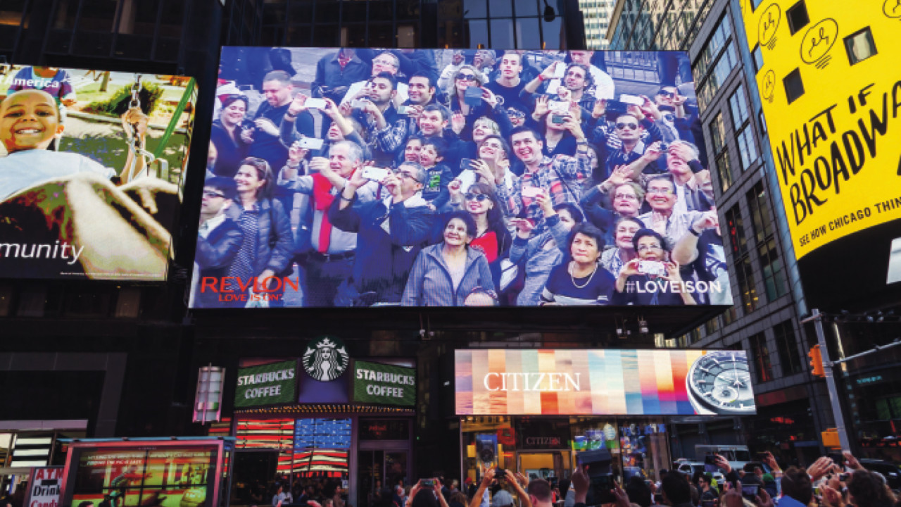 The big screen at New York's Times Square displaying live video of pedestrians as they walk by