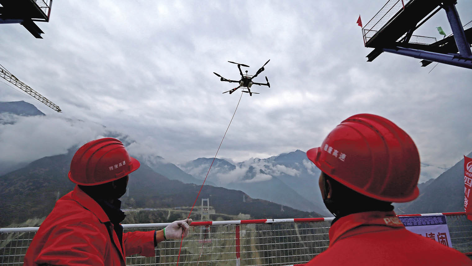 A drone towing a cable over the Dadu River in the construction of a 1.1km bridge in Ya'an, Sichuan Province, China
