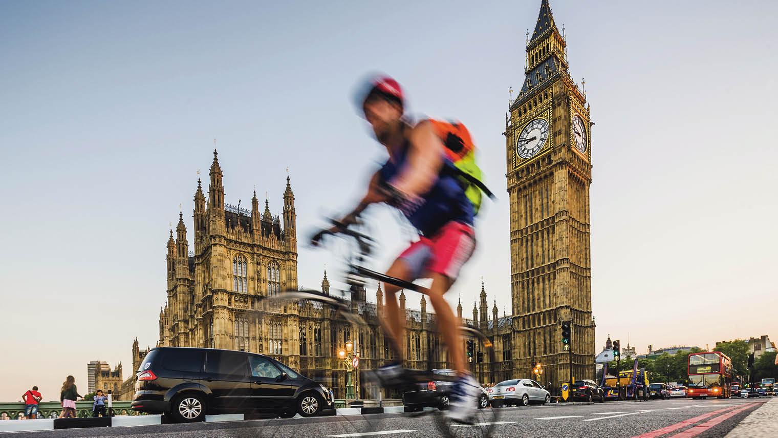 Man on bike outside Parliament