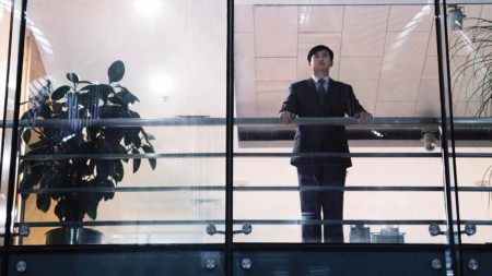 Business leader looking out of window