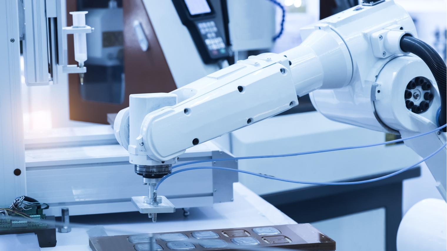 Robotic arm machine in factory
