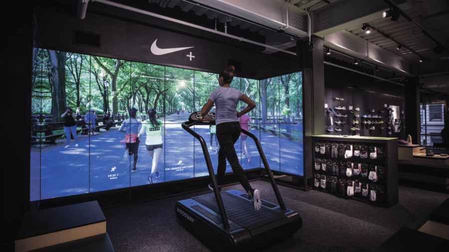 Lady running on treadmill in a Nike store