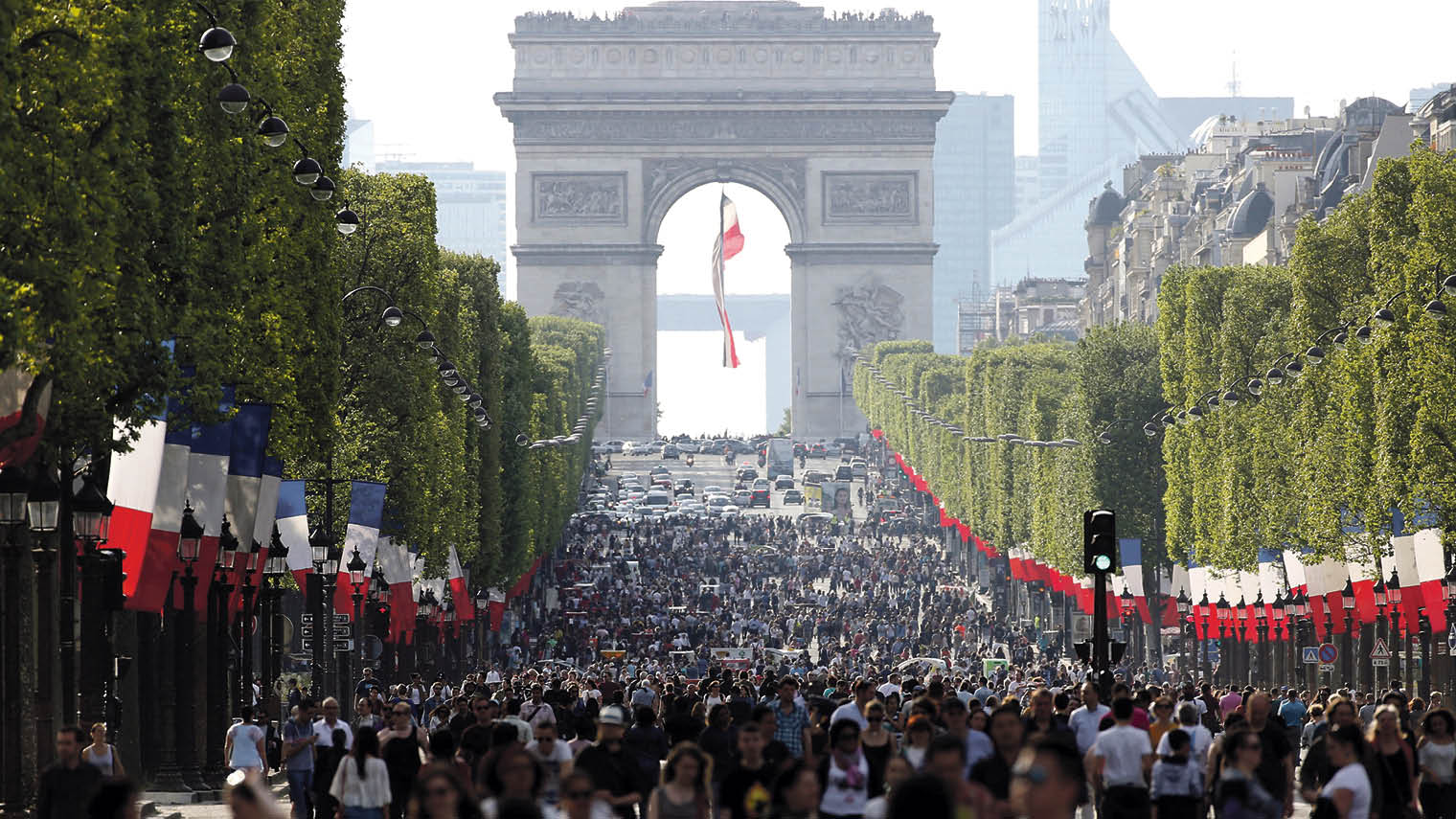 Pedestrians on the Champs-Élysées in Paris as the world-famous shopping street went car-free for a day last May to tackle pollution in the French capita