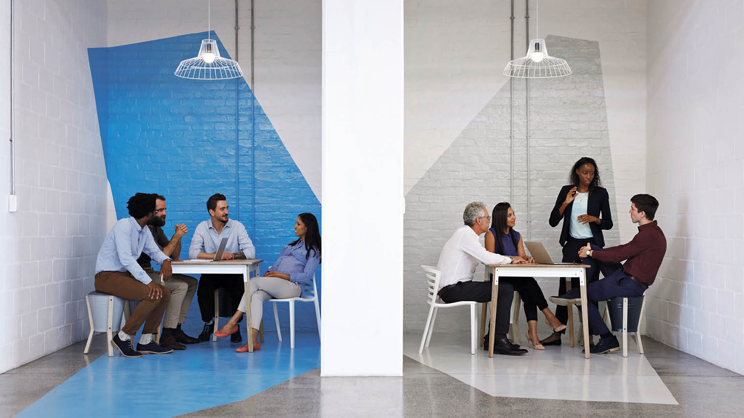 Two groups of employees sitting down