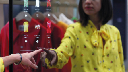 Woman shopping using a touchscreen