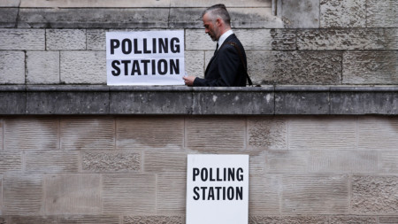 A voter leaves a polling station after casting his vote in the general election at St Giles Church in London, U.K., on Thursday, June 8, 2017. Britons vote today after an election dominated by Brexit, austerity and in the closing phases, security. Photographer: Luke MacGregor/Bloomberg via Getty Images