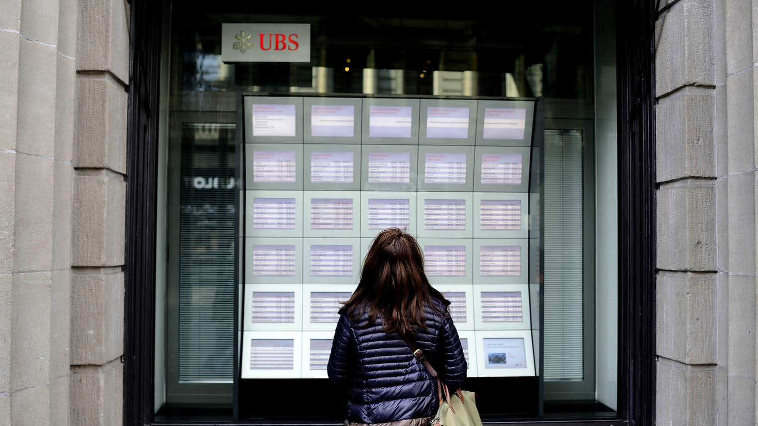 Woman standing outside UBS