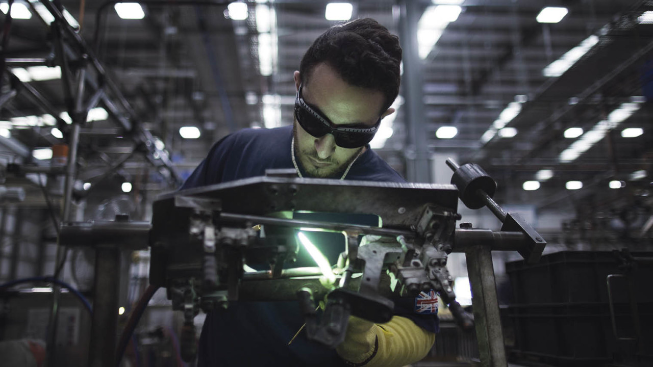 Employee welding parts at the Brompton Bicycle factory in London