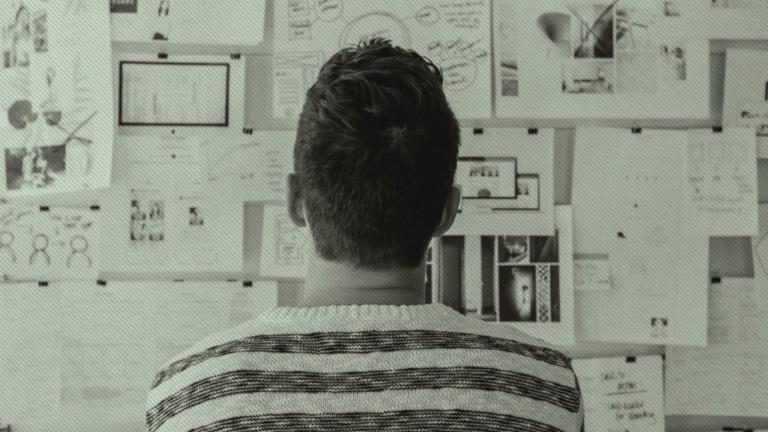 Man studying mood wall