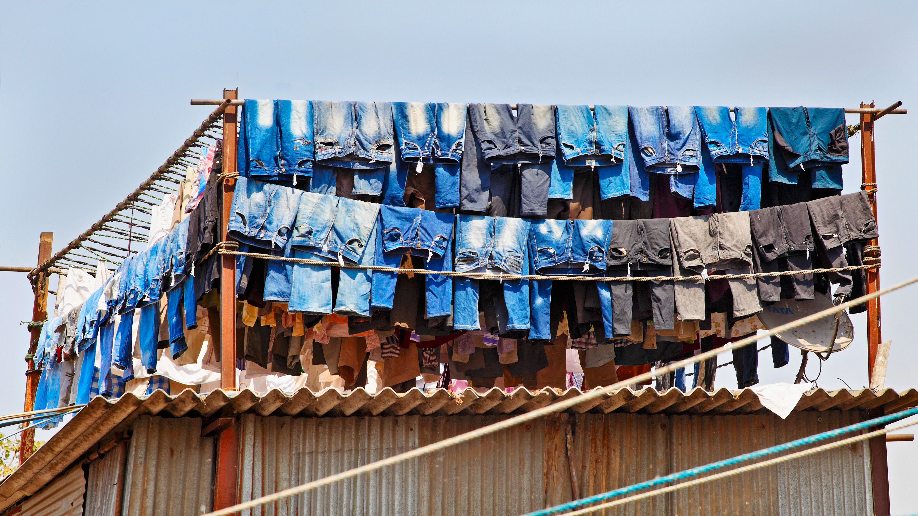 jeans hanging out to dry