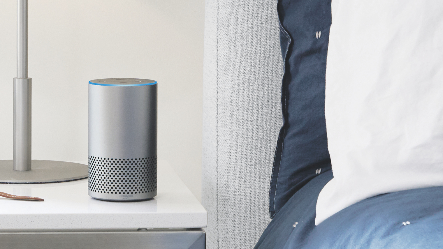 Amazon Echo on a bed side table