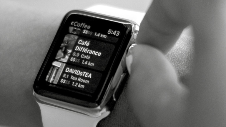 Person adjusting apple watch black and white