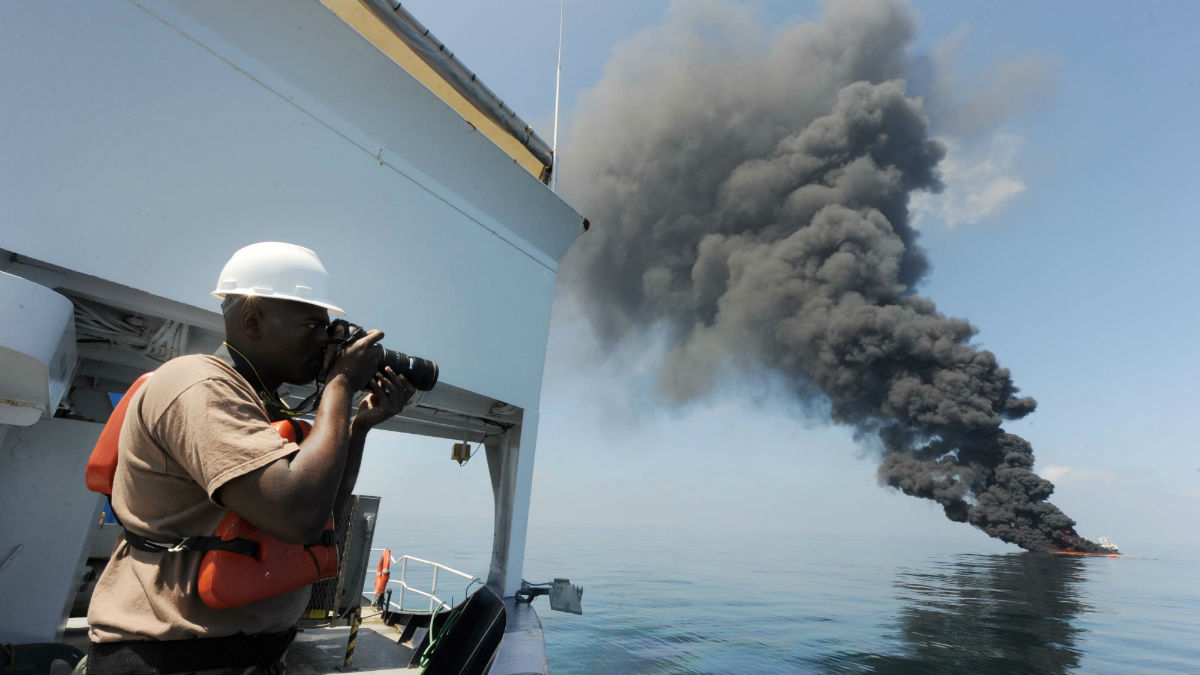 US Navy crew documenting controlled burn after Deepwater Horizon disaster